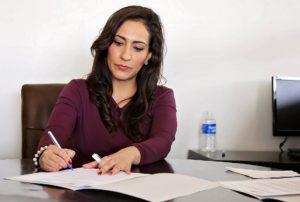 Finance manager filling out DMV paperwork